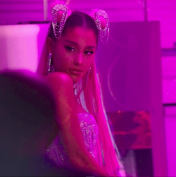 Ariana Grande poses for a photo while filming her controversial music video for her hit single 7 rings.