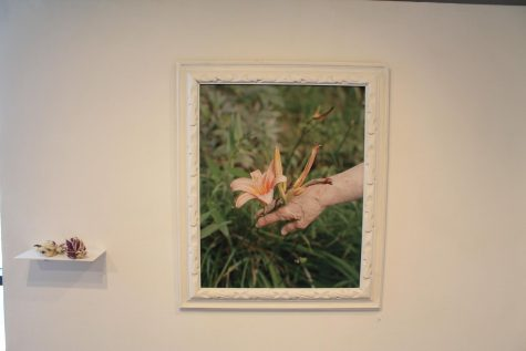 Motta's sentimental piece includes her grandmother's hand reaching out to touch a flower.