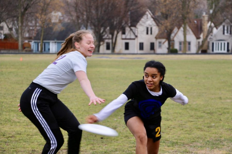 Senior and captain Rachael Johnson passes the frisbee against Cretin defender at the Girls Ultimate game against Cretin on Apr. 9 on Historic Lang Field.