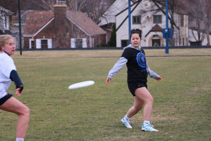 Senior and captain Elea Besse passes the frisbee.