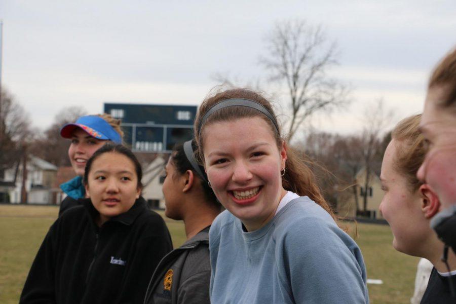 Sophomore Pilar Saavedra-Weis cheers on her teammates.