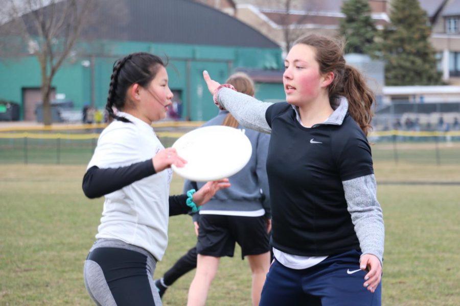 Sophomore Allison Audette defends against a Cretin player.