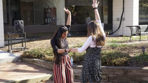 Seniors Mashal Naqvi and Isabel Saavedra-Weis enjoy the warm weather and energizing music.