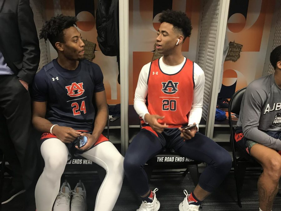 Auburn+players+talk+during+a+Final+Four+press+conference+during+the+2019+March+Madness.