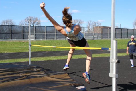 Junior Alessandra Costalonga warms up her high jump.