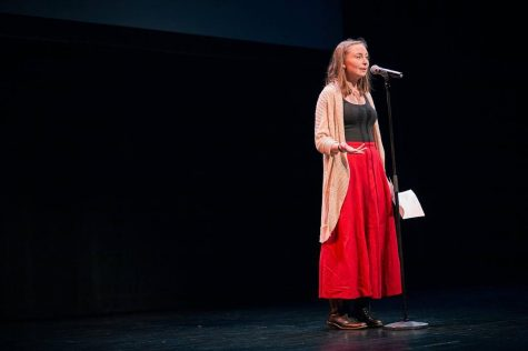 Junior Anna Snider performs at a poetry slam.