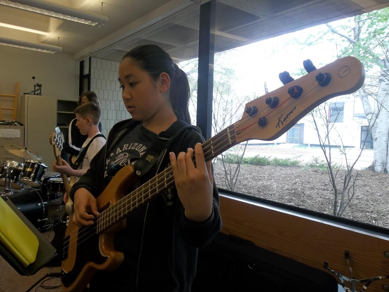 Sophia+Bietz+is+practicing+her+bass+guitar+before+class+starts.