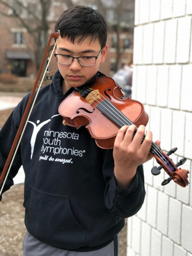 9th+grader+Kai+Sih+spends+hours+with+his+violin+playing+with+a+traveling+orchestra+in+addition+to+SPA%27s+orchestra.+