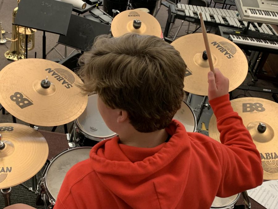 Jake Therian plays percussion in Jazz Band. He said it isn't hard to learn to play the drums: