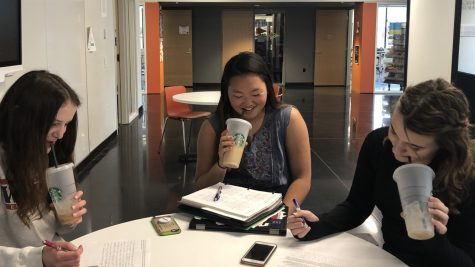 Sophomores Eloise Duncan, Jasmine White, and Maxanne Millerhaller take a sip of coffee from their starbucks cups.