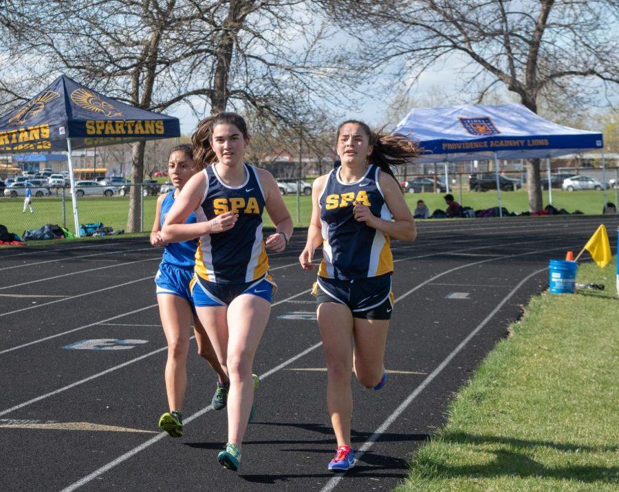 Senior Eliza Reedy and sophomore Isabel Isabel Toghramadjian halfway through their 1600m race.