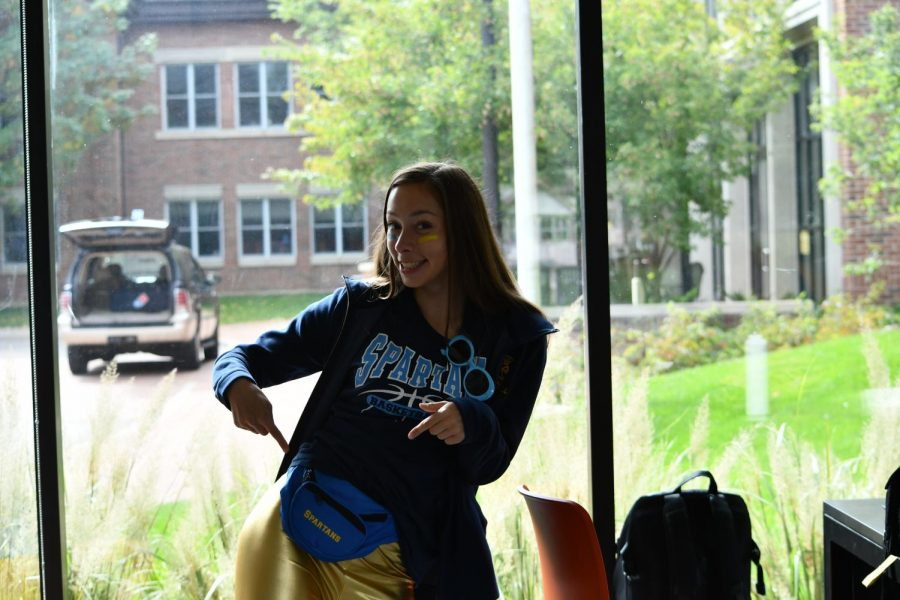 Junior Julia Baron points to her blue and gold fanny pack from SPA's 2017 homecoming.