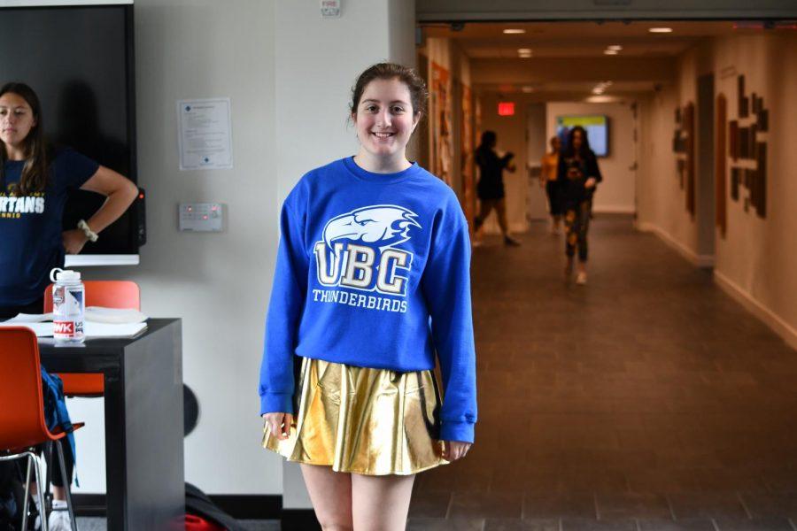 Although not wearing a sweatshirt that supports her own school, junior Isabelle Wolpert wears a gold skirt.