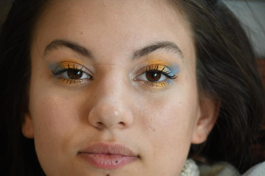 Junior Tana Ososki did an ombre makeup look of blue and gold eyeshadow.