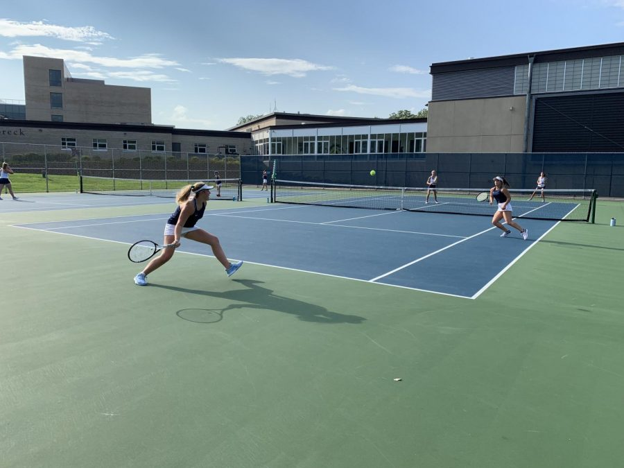 One of the four doubles  matches last night. The Girls Varsity Tennis team currently holds a record of 5-3.