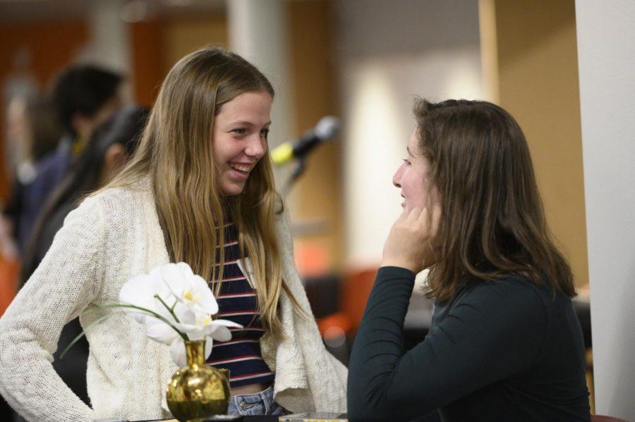 Sophomore Clara Garner and junior Isabelle Wolpert talk at the Grand Opening.