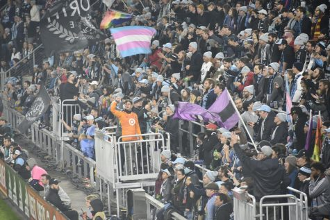 "MNUFC wonderwall leads chants. ""The game has a boisterous energy that electrifies the crowd. It makes everyone feel part of the atmosphere,"" 9th grader Jack O'Brien said."
