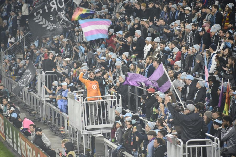 """MNUFC wonderwall leads chants. """"The game has a boisterous energy that electrifies the crowd. It makes everyone feel part of the atmosphere,"""" 9th grader Jack O'Brien said."""