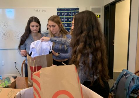Community Action and Service collects shirts for Haiti