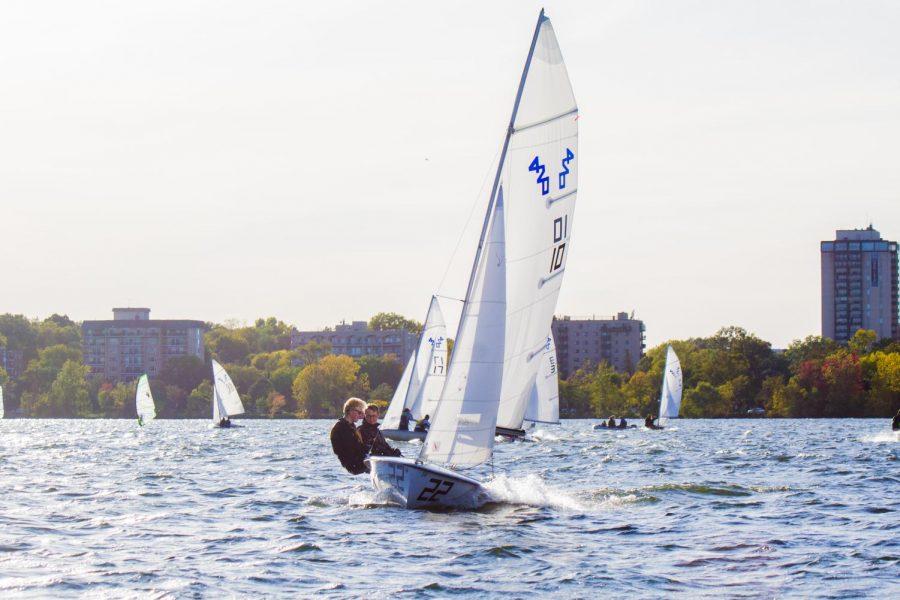 Juniors TJ Isberg and Phineas Tait sail through the waters of Bde Maka Ska.