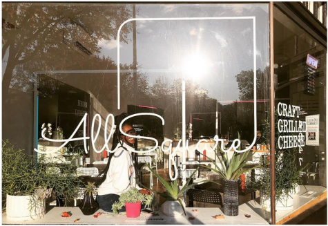 The storefront of All Square on Hiawatha Avenue where Mia Hofmann spent for summer is warm and inviting.