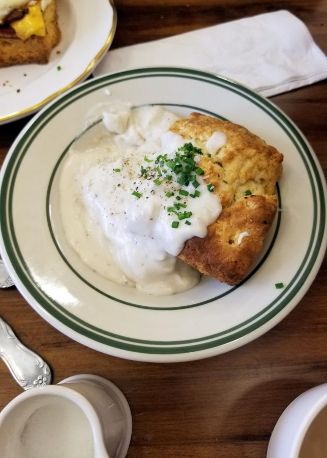 The biscuits and gravy menu item features the Hot Hands biscuit with a house-made buttermilk gravy.