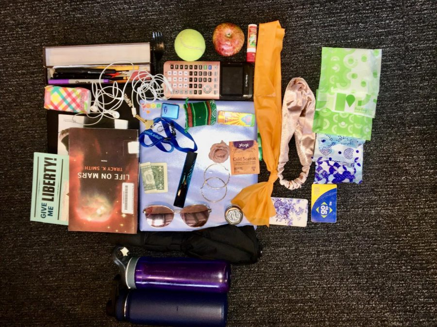 Junior Gabriella Thompson's backpack carries school supplies, snacks, and random things that are handy to have when bored.