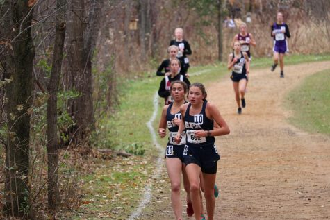 9th grader Becca Richman and 8th grader Violet Benson raced near eachother.