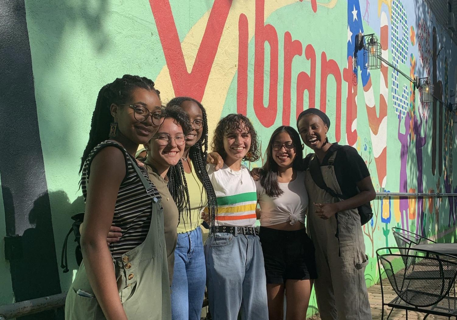 """META. META founders, Winfrey Oenga, Ana Keller-Flores, Ijeoma Ugboajah, Sara Flores, Britney Chino, and Miski Omar gather for a photo. """"META started this past summer after I and a few other friends who were all a part of a different youth organization came together and realized [that] organization, while being a great segue to being involved in our community, wasn't directly going after the things we wanted,"""" co-founder Britney Chino said."""