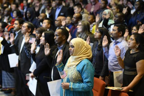 New U.S. citizens recite after the judge during the swearing in ceremony.