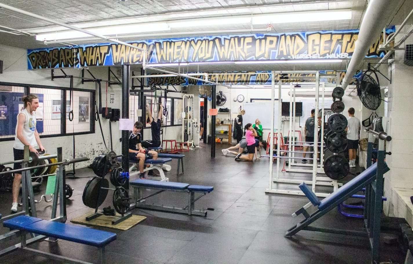 The weight room is filled with mostly male-identifying students with a few female-identifying students after school. This gender imbalance becomes more severe when sports do not use the weight room for conditioning.