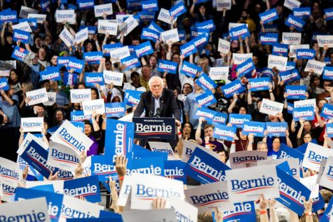 CHEER ON BERNIE. Sanders engages with the crowd as they shout chants and encouragements and raise signs printed with his name to show their support. His voice and words do not quit the crown instead it makes them raise their signs higher.