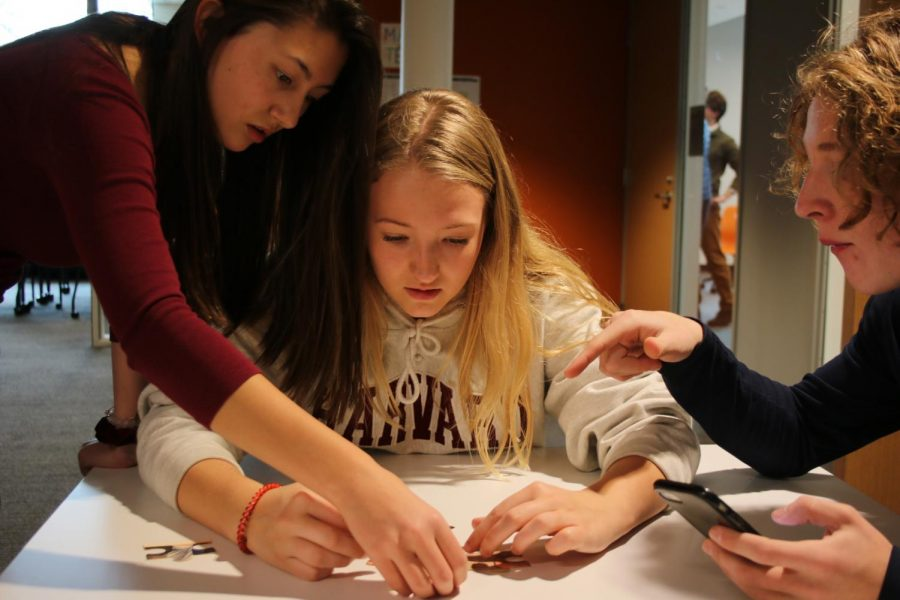 Sophomores Esther Allen, Sarina Charpentier, and Judah Thomas work together to piece together the last hint.