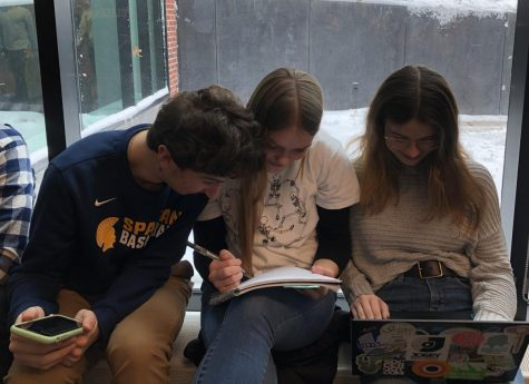Juniors Noah Lindeman, Sara Browne and Grace Tilney-Kaemer study for an exam together.