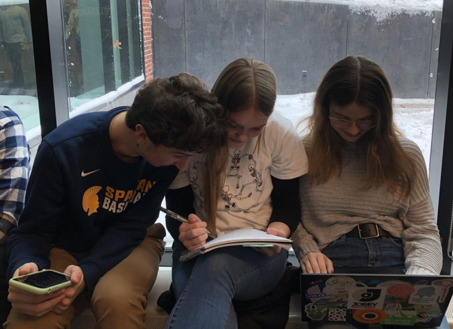 Juniors Noah Lindeman, Sara Browne and Grace Tilney-Kaemer study for an exam together.