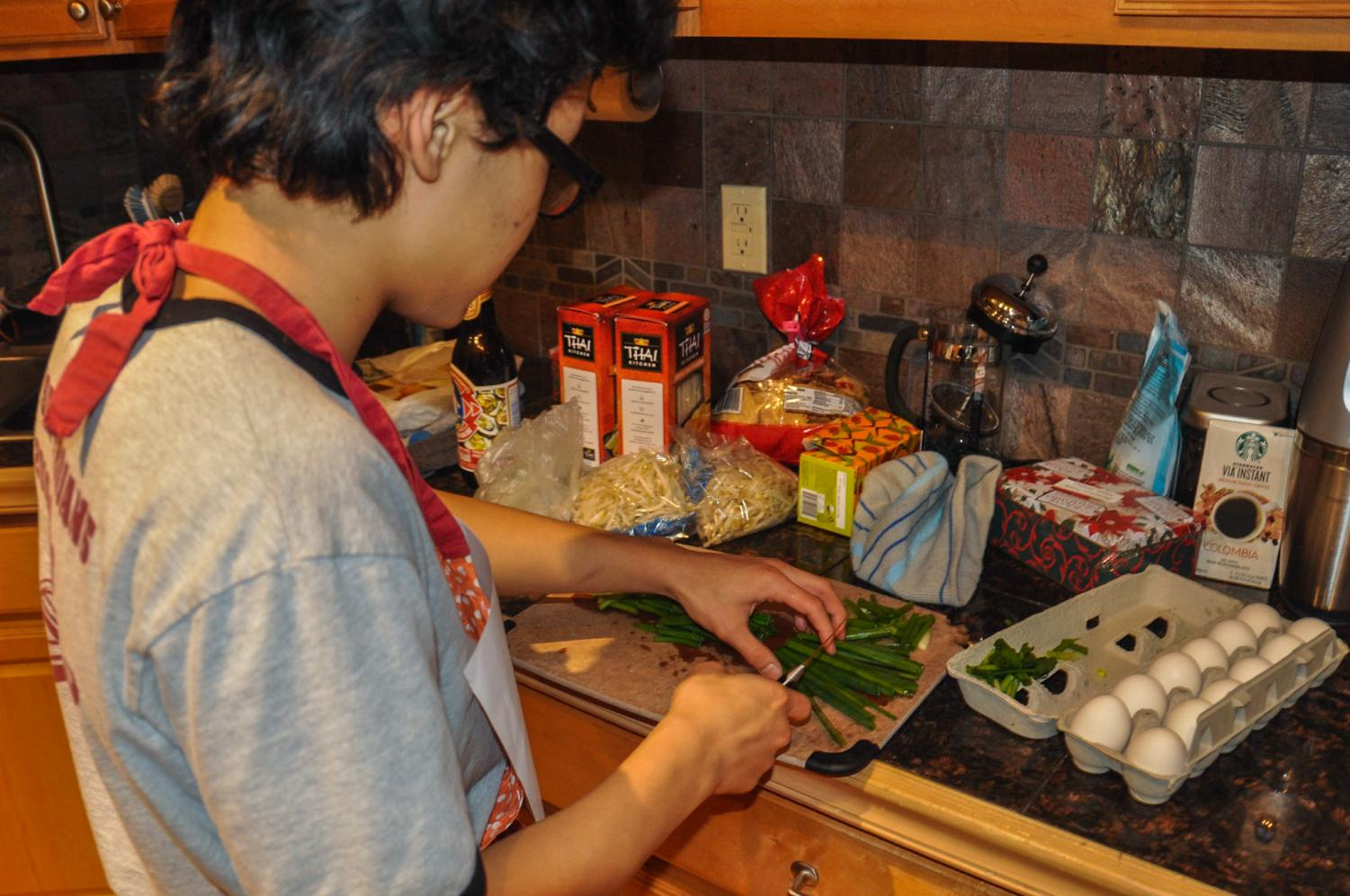 Pah Nah chopping vegetables for the stirfry