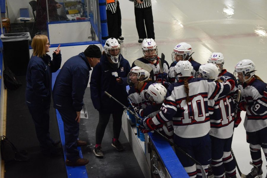 Team members huddle and get advice from their coach.