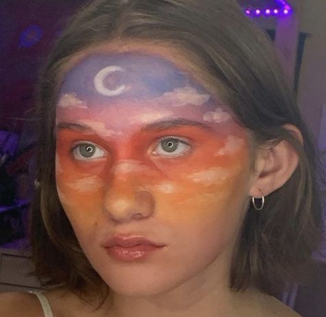 HEAD IN THE CLOUDS. Sophomore Maggie Baxter uses her face as a canvas for unique makeup designs.