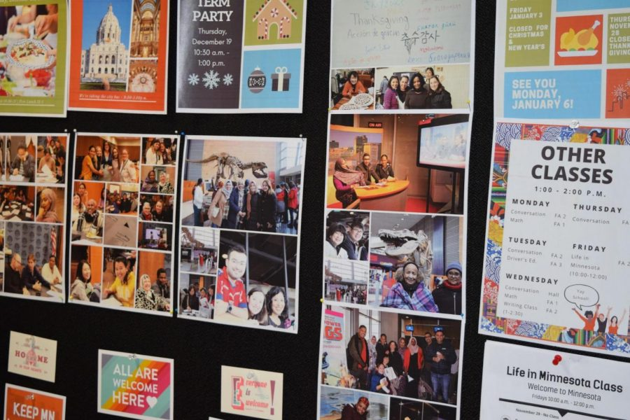 """The bulletin board displays many pictures of people who have come to the Institute. You can also check out what types of classes the Institute offers. """"So the first thing we do for refugees who arrive is we are responsible for taking care of them for the first 90 days that they're in the United States."""" Donahue says."""