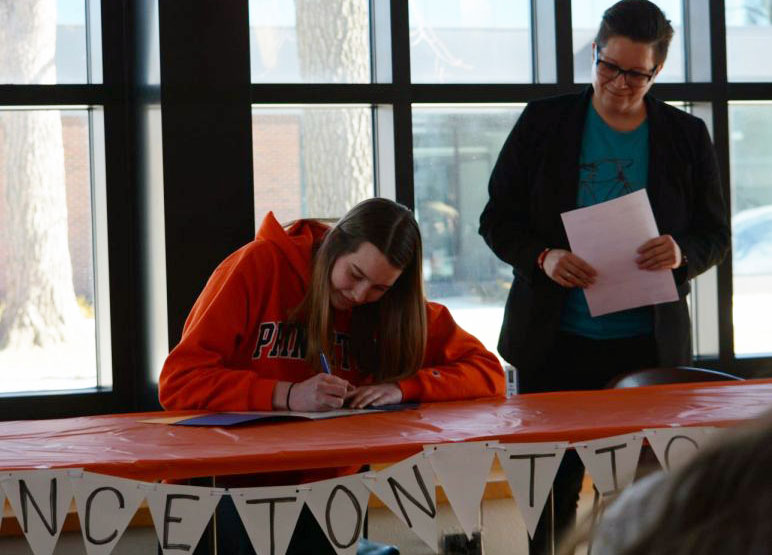 Senior Kathleen Bishop signs the official document to play D1 volleyball at Princeton University.