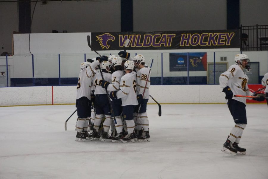The Spartan hockey team celebrates after their big win against Highland last year by hugging each other.