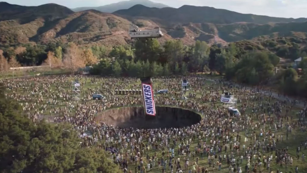 A picture from the snickers add as peace is restored to the world thanks to snickers