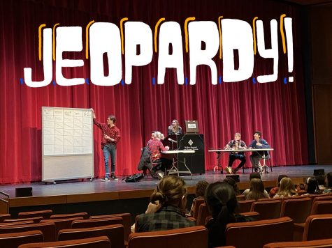 The judges, senior Sydney Therien and junior Gavin Kimmel and contestants, Ninth grader Tenzin Bawa, sophomore Ellie Dawson-Moore, junior Noel Abraham, and senior Henrik Schleisman laugh hysterically at an answer to one of the jeopardy questions.