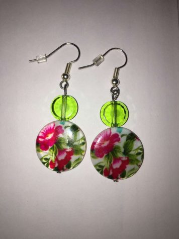 Junior Ruby Hoeschen made this pair of earrings with beads and other materials from Michaels.