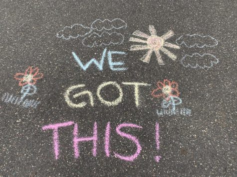 Encouraging messages are written on driveways for people driving past.
