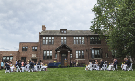 The graduating class of 2015 sits on the lawn for a traditional SPA graduation.
