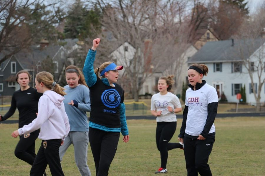 The Spartan Ultimate team rallies around captain Sydney Therien