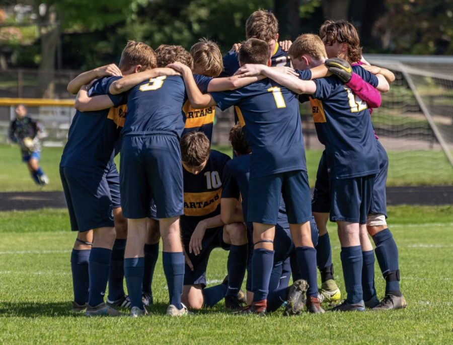 SPA boys varsity soccer in a team huddle on September 14, 2019, vs Providence Academy.