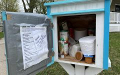 A Little Free Library is stocked full of necessities for those who need them.