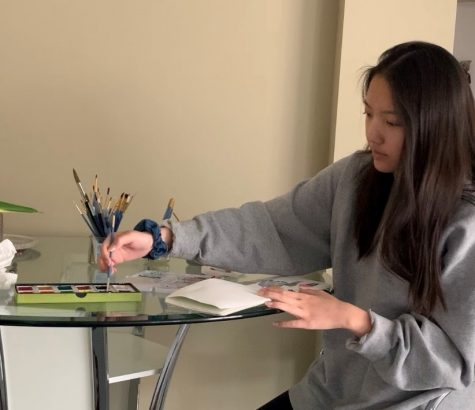 Senior Ashley Su works on her art seminar project from home.